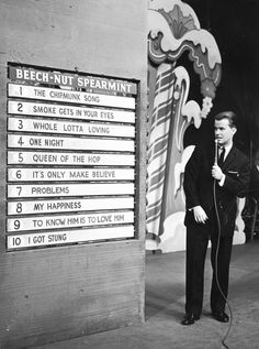Top hits  ( Hulton Archive / January 1, 1958 )  American TV show host Dick Clark announces the week's top ten popular songs during an episode of 'American Bandstand.'