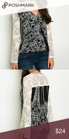 """Lace Bell Sleeve Top This top is simply beautiful. With full white lace bell sleeves and  black and white print, this surplice front top is bound to make an impression. Made from rayon.  Measurements laying flat: Bust from armpit to armpit   Small Length 20"""" front/ 24"""" back Bust 18 1/2""""  Medium  Length 21"""" front/ 25"""" back Bust 19""""  Large  Length 22"""" front/ 26"""" back Bust 19 1/2""""  Extra large Length 23"""" front/ 27"""" back Bust 20"""" Tops Blouses"""