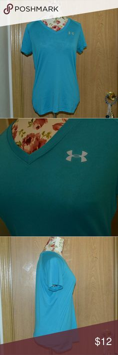 Under armour athletic shirt Smoke free home! I ship Monday-Friday! NO HOLDS OR TRADES! Buy 3 get one FREE!  A super cute turquoise short sleeved semi fitted workout  tee size SM/P/P heat gear. I don't know what the materials are. In good condition. Under Armour Tops Tees - Short Sleeve