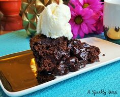 Hot Fudge Pudding Cake.This super simple cake batter bakes in to a wonderful chocolate cake with a warm fudge secret inside. The chocolate cake is soft and gooey and has a light crispy crust and a warm fudgy sauce hidden underneath.