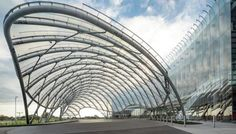 The undulating form of the canopy contrasts with the curve of the 300-foot-long glass curtain wall of the casino.