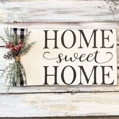 Winter greenery plus buffalo plaid ribbon on a home sweet home sign is perfect for your home decor all winter! Size: 16.5 x 8.25 inches Wood Signs For Home, Diy Wood Signs, Home Decor Signs, Rustic Signs, Wooden Decor, Wooden Diy, Diy Crafts For Home Decor, Plaid Decor, Coffee Club