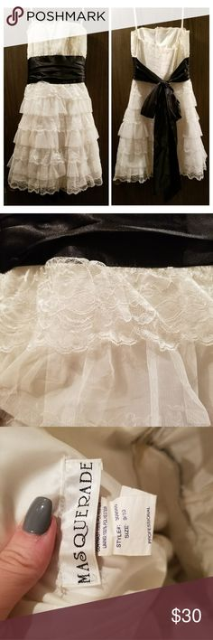 Vintage lace  Prom dress Strapless. Off white lace with black satin bow. Hidden zipper. Mid length. Worn years ago for my prom. Says size 9/10. Fits like a medium Dresses Strapless