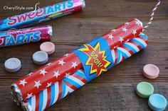 4th of July candy firecrackers get a big 'thumbs up' from the kids! A free printable and twisted rope ribbon easily turn rolled candy into fun party favors.