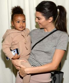 North West looks adorable smiling with Penelope Disick in this photo posted by Khloé Kardashian at her book launch.