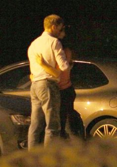 2009 Kate just couldn't resist stealing a kiss from her prince as they strolled back to their car after a romantic evening out at the Potting Shed Pub in Crudwell, in July 2009.