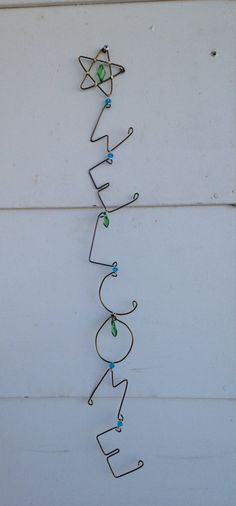 Hanging wire welcome sign with silver wire and blue and green bead accents. 25 long