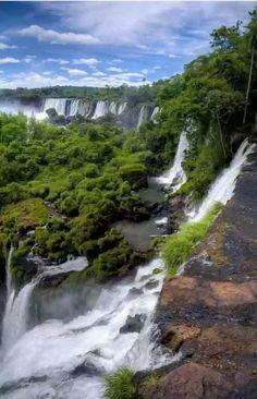 Iguazu Falls on the border between Argentina and Brazil - TravelManiacsHub.com