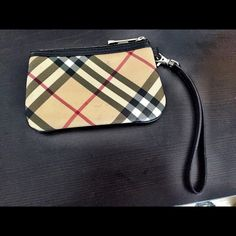 Burberry Wristlet Checkered Burberry Wristlet. Has tiny black marks throughout (please look carefully before purchasing). Burberry Bags Clutches & Wristlets