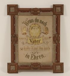 "Victorian punch paper needlework religious motto in German in polychromed tramp art frame. Embellished with celluloid angels, dried flowers, pearls and metallic thread. Overall; 23"" x 18 1/2""."