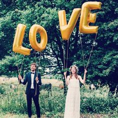 L O V E is in the air.  Cute wedding photo with balloons.   mysweetengagement.com