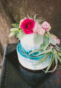 pink flowers on blue + white cake // photo by Colagrossi Studio, cake by Caitlin Kelley Cakes, view more: http://ruffledblog.com/riverside-bohemian-wedding-shoot/