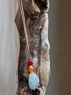 Aquamarine pendant necklace. Necklace made with a big aquamarine faceted nugget,  carnelian nugget and cube.