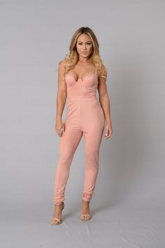 - Available in Black and Blush - Adjustable Spaghetti Strap - Faux Leather - Padded Neckline - Skinny Leg - Zipper Closure - 95% Polyester 5% Spandex - 100% Polyester