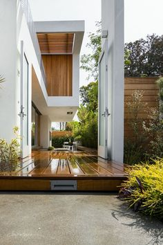 Doors aren't just for the skin of a building to divide 'inside' from 'outside'.  Great big doors are used here to create a threshold to an outdoor space. Just The Design Via Kathleen Ferguson