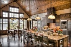 I like the way this makes modern appliances and a modern island setup seem natural in a log cabin setting.