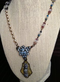Hey, I found this really awesome Etsy listing at http://www.etsy.com/listing/157710738/blue-rhinestone-vintage-rosary-crystal