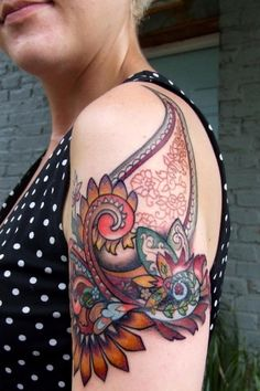 i'm not the biggest fan of coloured tattoos, but i love the teal and maroon in this