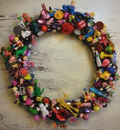 60thisyear:  Just completed my 2015 Christmas wreath, stuck with tiny toys, rhinestones, beads, broken jewellery and found objects.