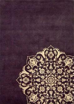 Aubergine rug with gold design