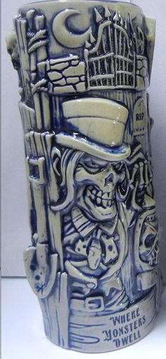 Chillinghast's Dark Lantern Tiki Mug. The Collector strides through the hideous darkness, amidst the forgotten tombs of scores. His Dark Lantern, filled with the spirits of the dead, is raised high. Tiki Art, Tiki Tiki, Tiki Glasses, Tiki Hawaii, Tiki Lounge, Metal Embossing, Tiki Room, Bbq Party, Haunted Mansion