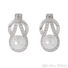 """Every Detail """"Every Detail"""" of design and craftsmanship is evident in these classic pearl earrings studded with Swarovski's clear crystals to enhance their beauty.  Earrings with sterling silver posts  Nickel, lead and cadmium free. http://www.fifthavenuecollection.com/every-detail-es-deta-st-09"""