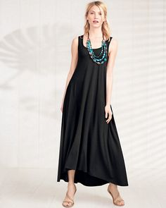 We're head over heels in love with this maxi-dress fabric — a cotton/modal mix that holds deep color beautifully and glides over the body like nobody's business. The simple scoop-neck silhouette with a slightly tipped hem offers dress-up/dress-down potential — shift the look with flip-flops one day, statement jewels the next.