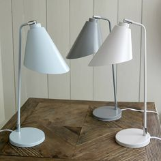 Adjustable table lamp in a selection of shades.Bloomsbury metal table light in three subtle shades of duck egg, mid grey and soft white - a colour range to suit many room schemes. With an adjustable head making it an ideal reading or desk lamp and great looking design the Bloomsbury enhances any living or working space. Requires a E14 25W bulb.MetalH48 x W15 x D32cm