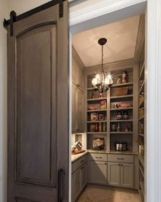 Spacious and organized pantry area with an appealing sliding door that adds character to the entire space. Spacious and organized pantry area with an appealing sliding door that adds character to the entire space. House Design, House, Home, Interior Barn Doors, Home Remodeling, New Homes, Kitchen Layout, Pantry Design, Kitchen Design