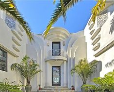 Art Deco style evokes movie star inspired Hollywood glam. A mix of smooth swirls, curves and lines with white render finish.
