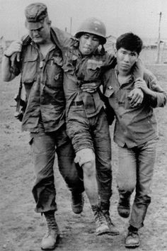 General Norman Schwarzkopf - Schwarzkopf and a Vietnamese paratrooper assist a wounded comrade after a Viet Cong mortar attack. Herbert Norman Schwarzkopf was a United States Army general who, while he served as Commander of U.S. Central Command, was commander of coalition forces in the Gulf War. The General was born August 22, 1934 and died December 27, 2012. - On AND Magazine http://www.andmagazine.com/content/phoenix/12681.html - Photo by Peter Arnett