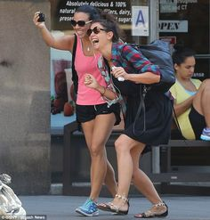 Katie Holmes and a friend had fun with a cell phone in New York City on Friday