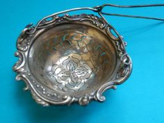 A-very-nice-French-Art-Nouveau-era-cast-solid-silver-fancy-tea-strainer