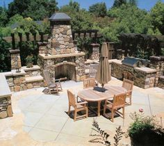Behind a 1915 house in Los Altos, California, an entire outdoor room was built around a stone hearth and a grille set into a stone wall.