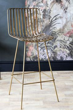 This simple stylish design bar stool is perfect for kitchen islands and bars The Midas Bar Stool is created in an antiqued gold metal and features
