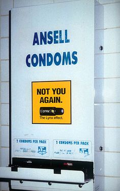 axe--not you again.  underneath a condom dispenser