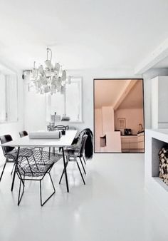 A clean monochrome palette and white concrete floor allows bold furnishings and daring decor to truly stand out #FieldNotes #styling #interiordesign #minimalist #scandinavian #monochrome #whiteconcrete #style