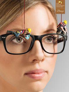 Photographer CURTIS TRENT - Fixing glasses - Advertising - Conceptual - BRONZE - One Eyeland Photography Awards 2015