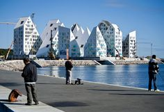 isbjerget housing project in aarhus by seARCH, CEBRA, JDS + louis paillard | together the triangular volumes appear as abstracted icebergs floating along the aarhus waterfront in denmark