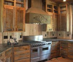 Reclaimed skip planed gray board cabinets and drawers. Cabinet doors have a tin inset. #reclaimedlumber #barnwood http://www.eaglereclaimedlumber.com
