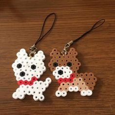 Puppy dog charms perler beads by r. Perler Bead Designs, Easy Perler Bead Patterns, Melty Bead Patterns, Perler Bead Templates, Hama Beads Design, Diy Perler Beads, Perler Bead Art, Beading Patterns, Peyote Patterns