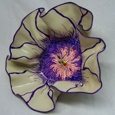 painted record flower! This would be great to try with records from the thrift store.: