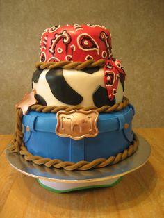 Cowboy western cake Cowboy birthday cake inspiration. cowboy cake table. mini hay bales. cowboy cake bandanna jean cake