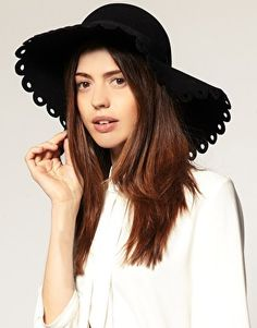 Scalloped brim floppy hat. Not normally a hat person but this one is too cute!