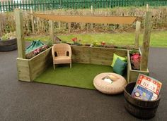 cozy kid corner in backyard, love the raised planter beds and little shade sail