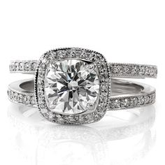 Unique diamond engagement ring has a round brilliant cut center stone surrounded by a cushion shaped halo and a double-micro pave band. This split shank design really sparkles! RB Cushion Cielo from Knox Jewelers