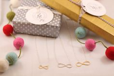 our Infinity Gold and Silver necklaces make simple and everyday wear gifts for the holidays. #beyoujewelry #handstampedjewelry #infinitynecklace