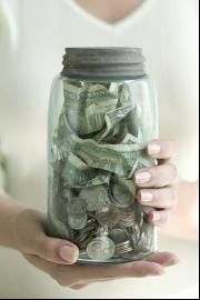 """The Christmas Jar. Have family put money in mason jar throughout year. At Christmas time, choose someone to bless (anonymously). On Christmas eve, deliver by Ring and Run. The book """"The Christmas Jar"""" explains how it all started."""