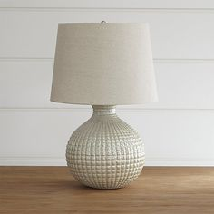 Classic ceramic sphere, richly textured and glossed in a pearly finish, glows…