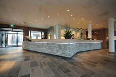 Reception Desk with Oppdal natural surface, and antique brushed surface.